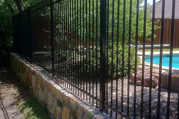 Sandstone Retaining Wall and Wrought Iron Fence