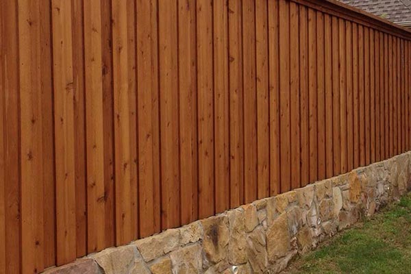 Builders Stone Retaining Wall and Cedar Board on Board Fence