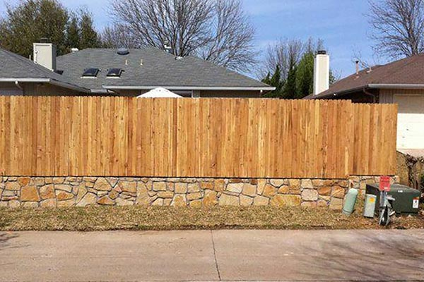 Stone Retaining Wall and Fence