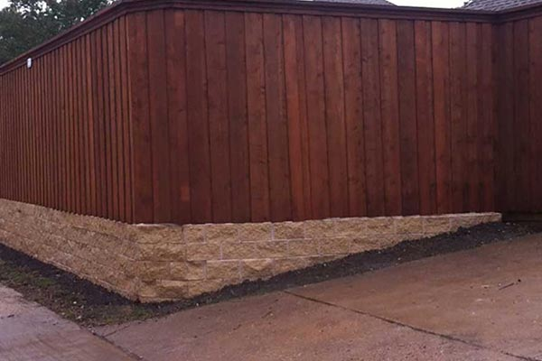 Block Retaining Wall and Cedar Fence